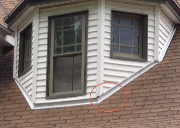 siding short of roofline