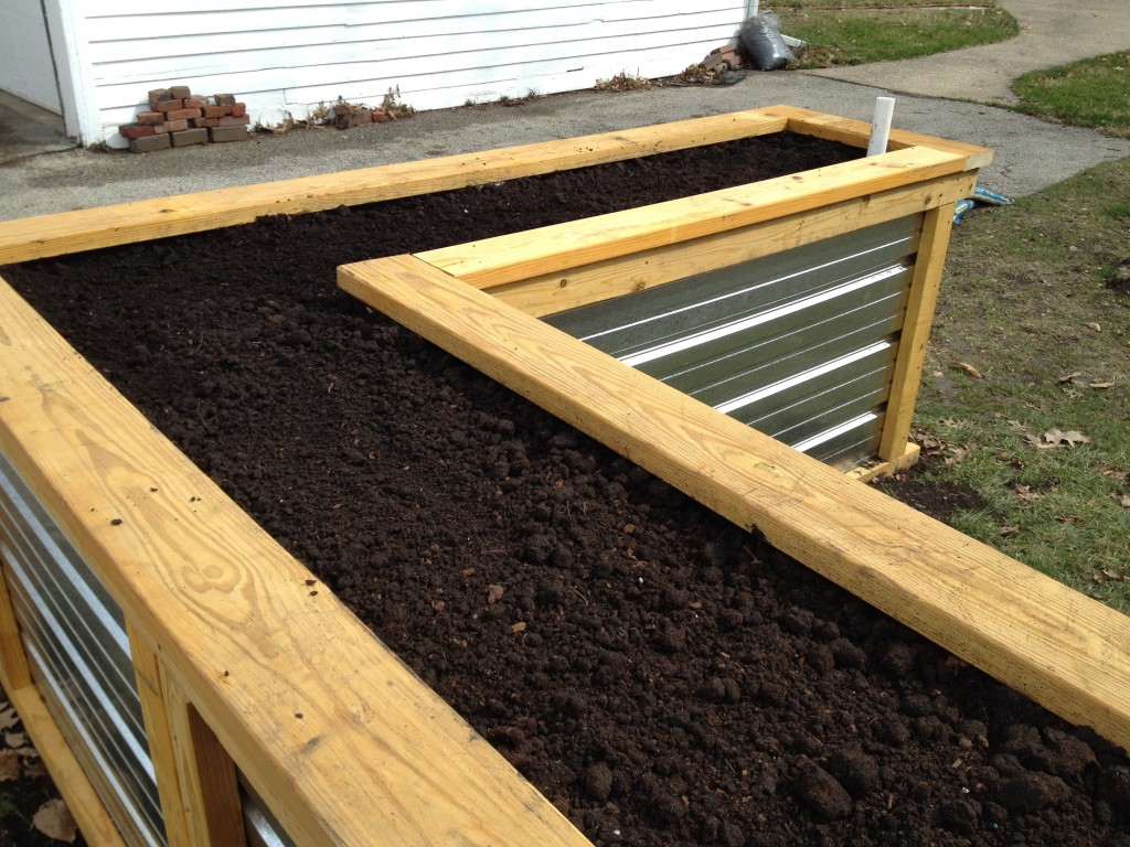 Building a self watering raised garden bed frugal living for Watering vegetable garden