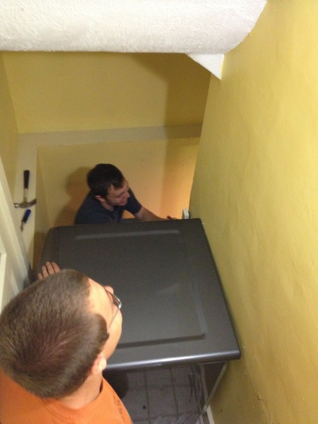 sliding a dryer down the stairs