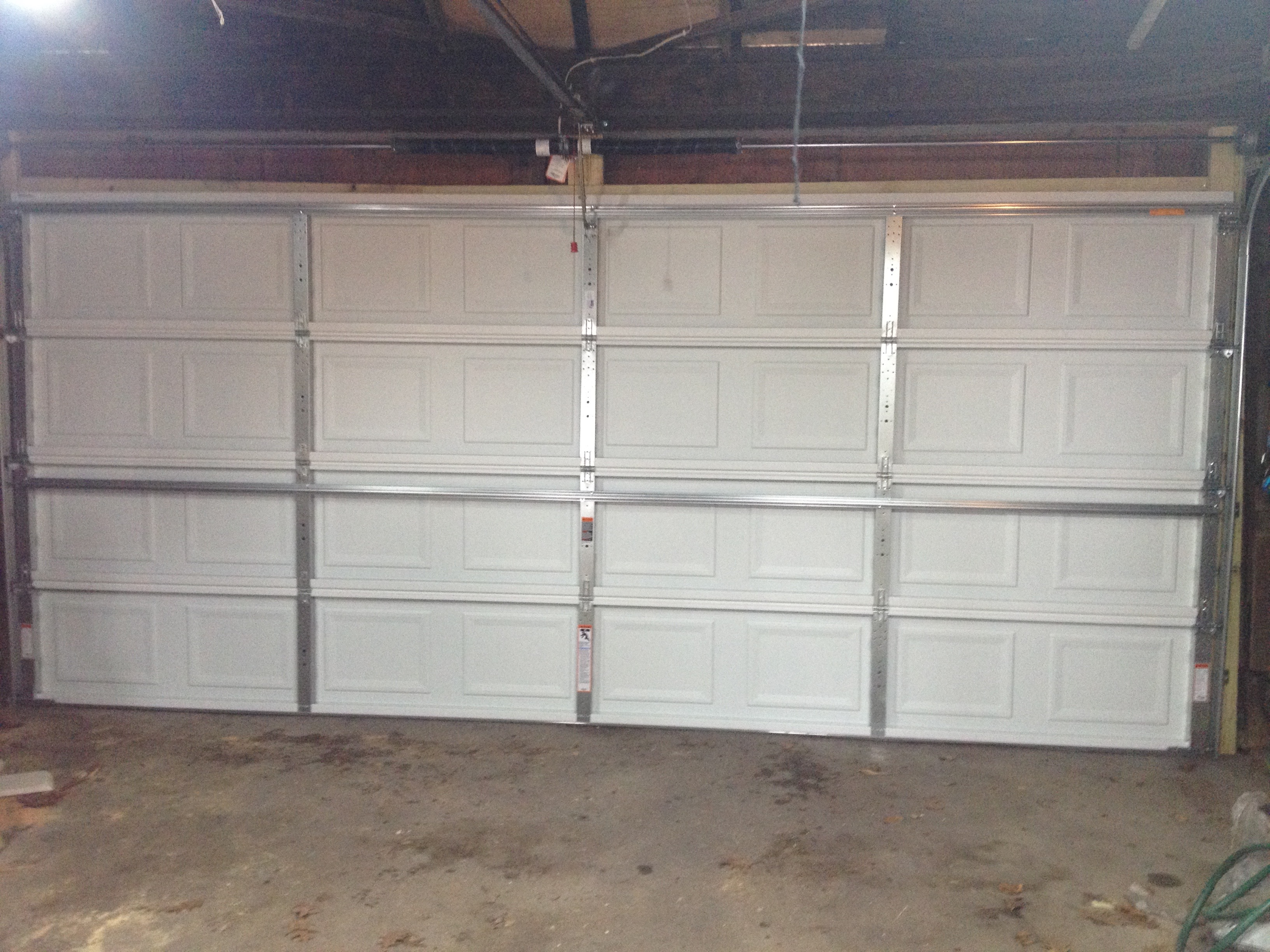 Replacing a worn out garage door frugal living and they did the complete replacement in just over two hours i asked them how many doors they do a week and they said 4 5 so they know their stuff rubansaba